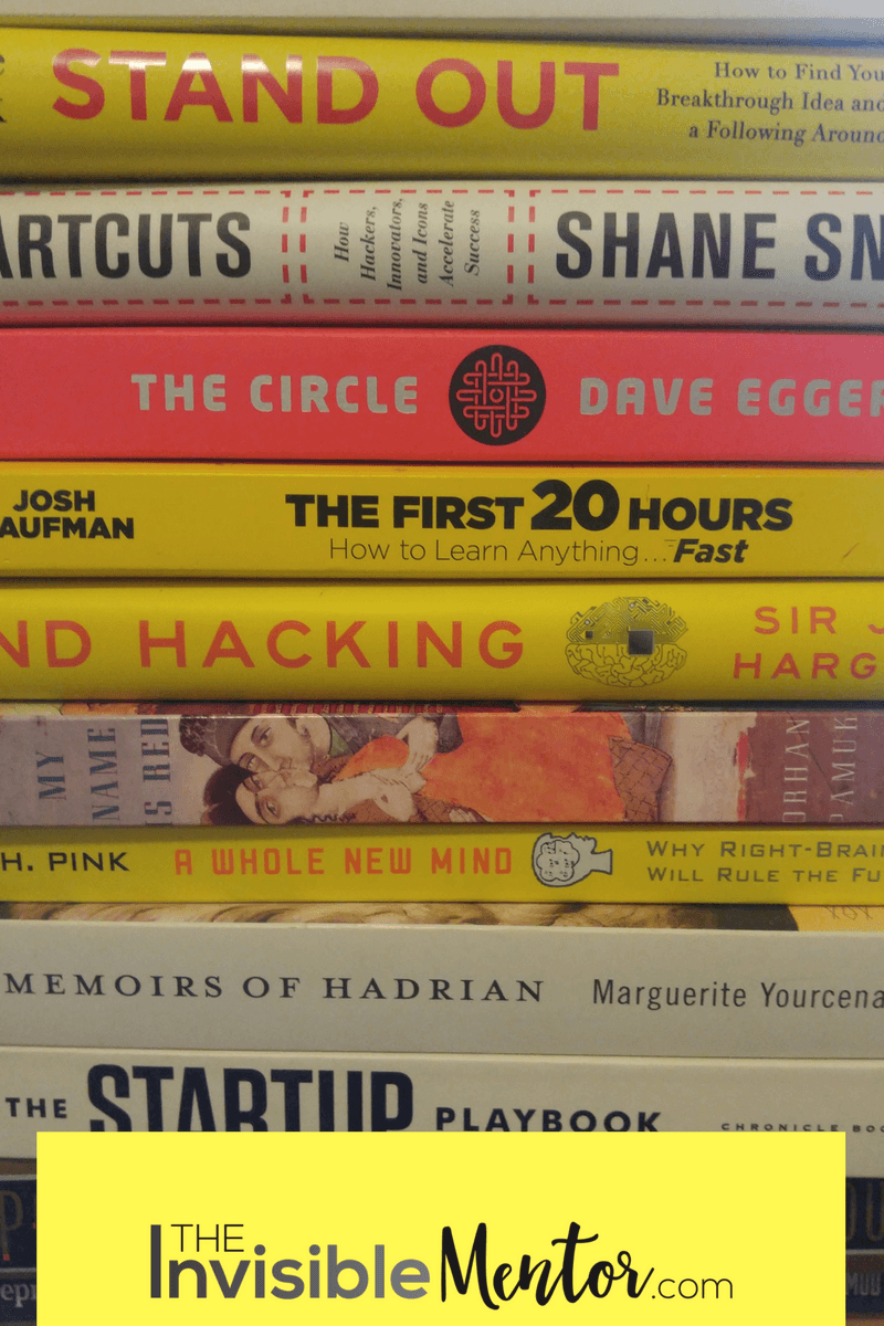 stack of books including stand out by dorie clark